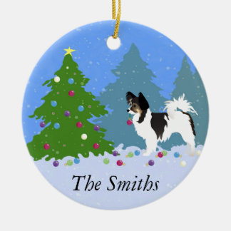 Papillon Dog Decorating Christmas Tree in Forest Round Ceramic Ornament
