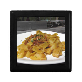 Pappardelle with mushrooms on rustic outdoor table gift box