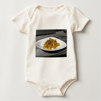 Pappardelle with mushrooms on rustic wooden table baby bodysuit