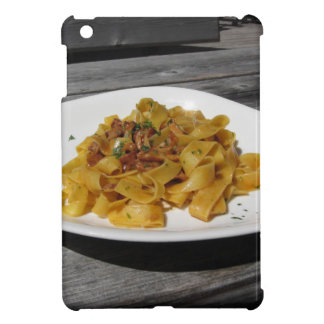 Pappardelle with mushrooms on rustic wooden table cover for the iPad mini