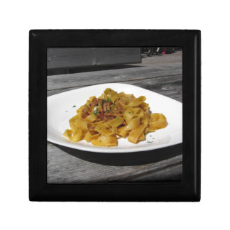 Pappardelle with mushrooms on rustic wooden table gift box