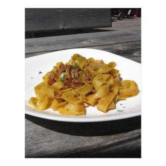 Pappardelle with mushrooms on rustic wooden table letterhead