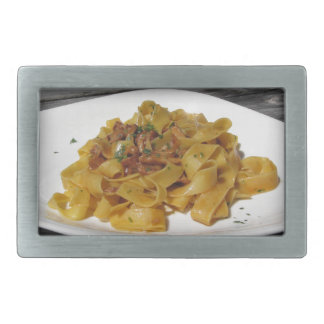 Pappardelle with mushrooms on rustic wooden table rectangular belt buckle