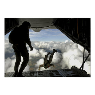 Pararescuemen jump out the back of a C-130 Poster