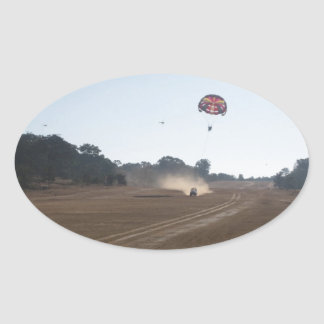 Parasailing behind a vehicle oval sticker
