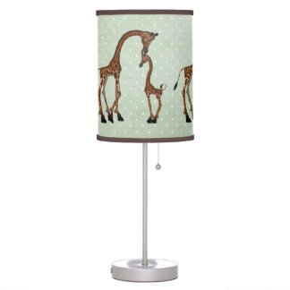 Parent And Baby Giraffe On Green Background Table Lamp