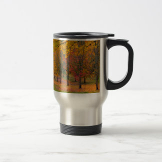Park with tree lined maple trees in peak fall colo travel mug