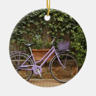Parked bicycle, Pienza, Italy, Tuscany Round Ceramic Ornament