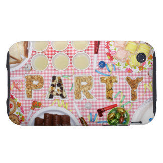 Party food on table in dishes spelling 'PARTY', Tough iPhone 3 Covers