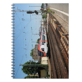 Passenger train in coarse home on the Rhine Notebook
