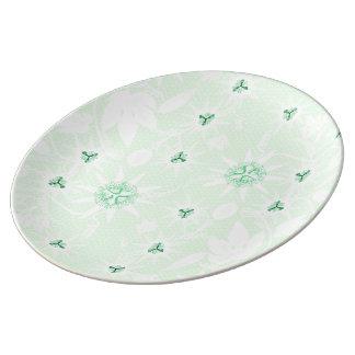 Passiflora vitifolia in pale porcelain plates