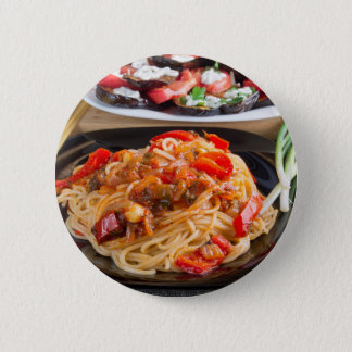 Pasta spaghetti with pieces of bell pepper 2 inch round button