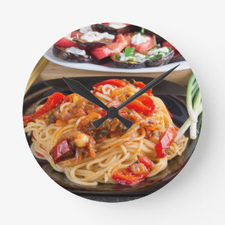 Pasta spaghetti with pieces of bell pepper clock