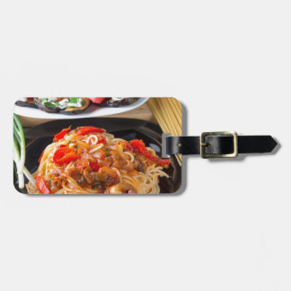 Pasta spaghetti with pieces of bell pepper luggage tag