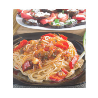 Pasta spaghetti with pieces of bell pepper notepad