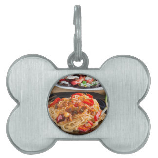 Pasta spaghetti with pieces of bell pepper pet tag