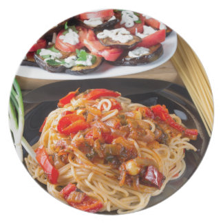 Pasta spaghetti with pieces of bell pepper plate