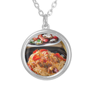 Pasta spaghetti with pieces of bell pepper silver plated necklace