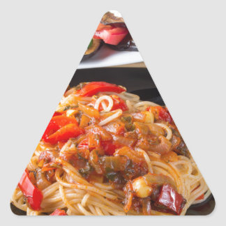 Pasta spaghetti with pieces of bell pepper triangle sticker