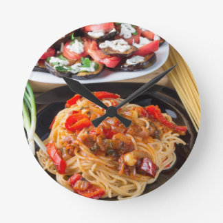 Pasta spaghetti with pieces of bell pepper wallclock