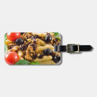 Pasta with bolognese sauce, beef meat, olives luggage tag