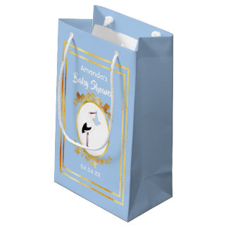 Pastel blue baby shower boy gift bag with a stork