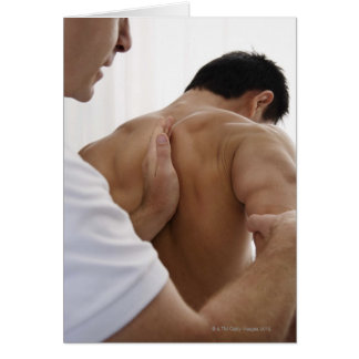 Patient receiving osteopathic treatment card