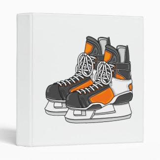 Patins oranges d'hockey classeur