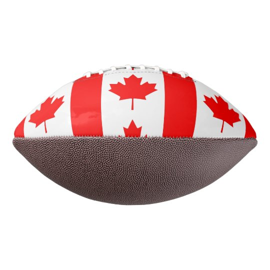 Patriotic american football with flag of Canada