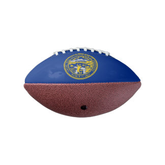 Patriotic american football with Nebraska flag
