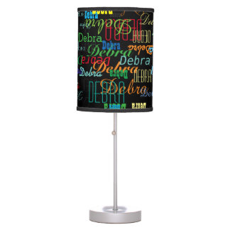 pattern of colorful names on black table lamp