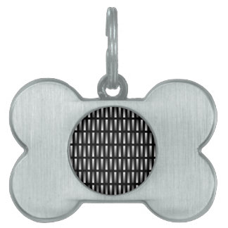 Pattern of grey rectangles with black background. pet ID tags