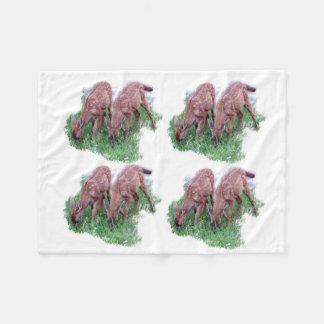 Pattern of two fawns grazing fleece blanket