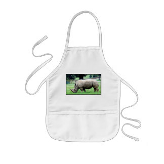 Pâturage du tablier des enfants blancs de rhinocér