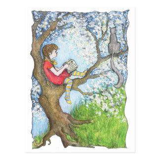 Pauline reading up the tree postcard