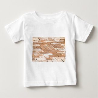 Pavement of brown tiles - close up view baby T-Shirt