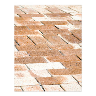 Pavement of brown tiles - close up view letterhead