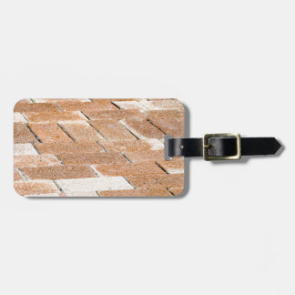 Pavement of brown tiles - close up view luggage tag