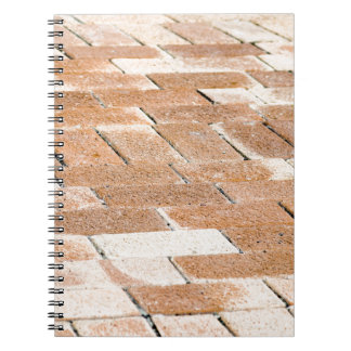 Pavement of brown tiles - close up view notebook