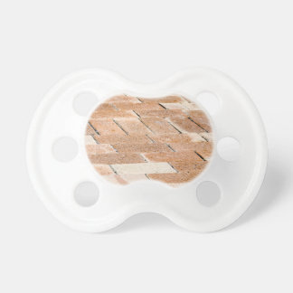Pavement of brown tiles - close up view pacifier