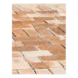 Pavement of brown tiles - close up view postcard