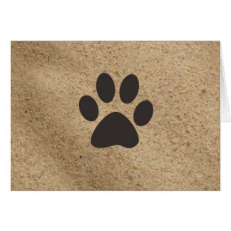 Paw prints in the sand card