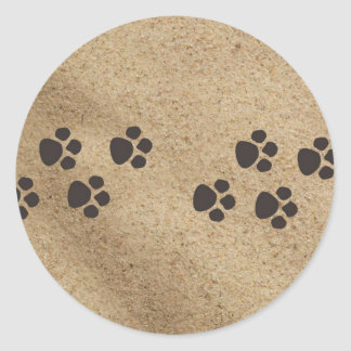 Paw prints in the sand classic round sticker