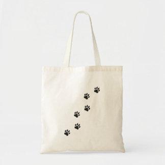 Paw prints of a cat tote bag