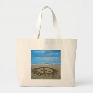 peace at the ocean large tote bag