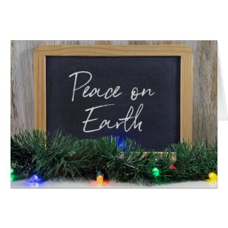 Peace On Earth sign on black chalkboard Card