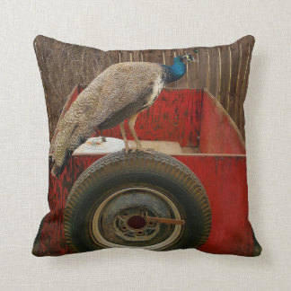 PEACOCK RESTING ON OLD RED TRAILER THROW PILLOW