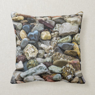 Pebbles on a beach throw cushion
