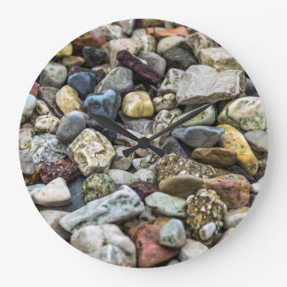 Pebbles on a beach wall clock