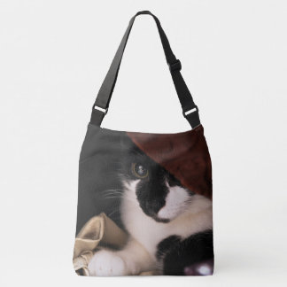 Peek-a-boo kitty cross body tote